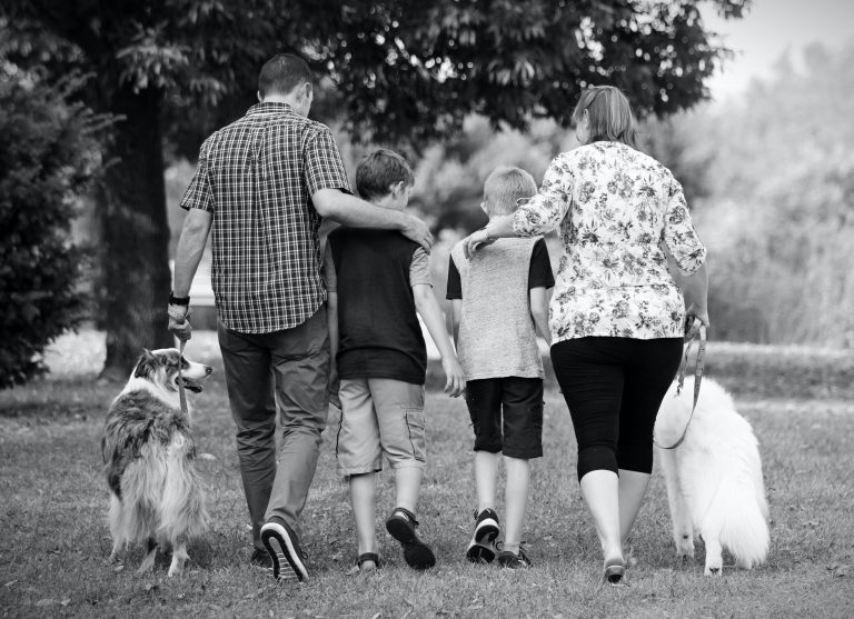 family walking with dogs
